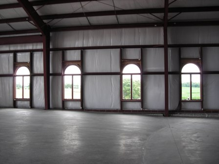 Four windows relocated from old worship space July 3