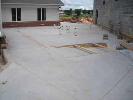 New floor is poured for additon July 3